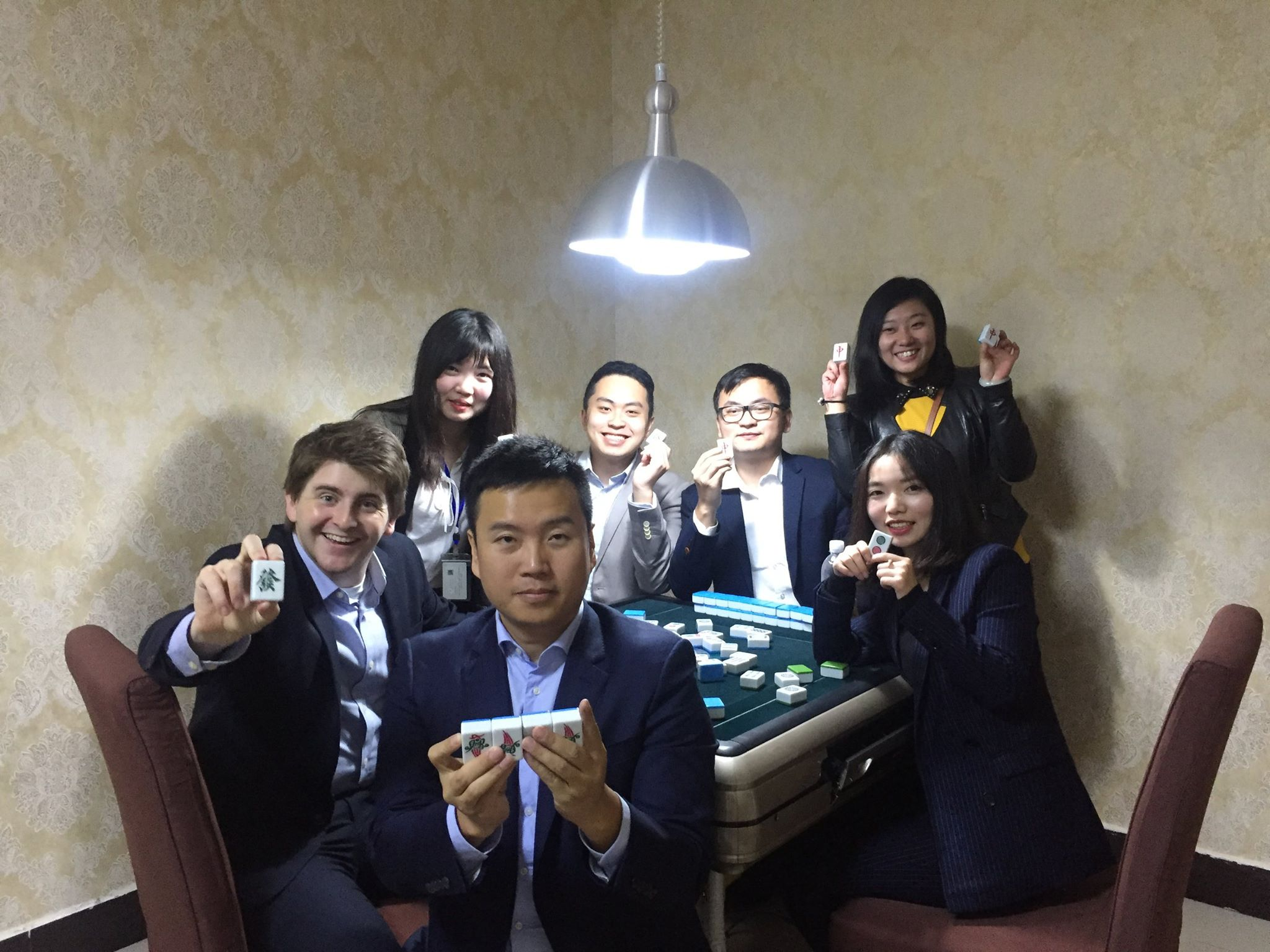Dylan with his Princeton in Asia co-fellow (center, back) and their China pals learning to play mahjong in Xiangyang, Hubei province, late 2017.