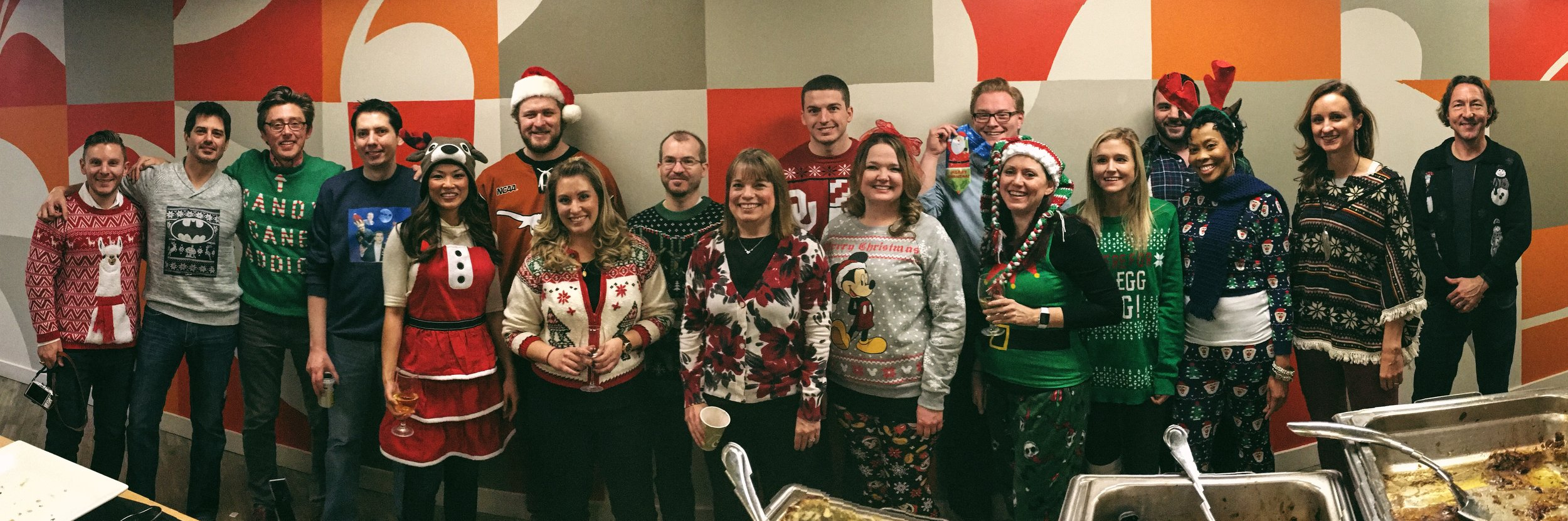 Our Dallas team gets into the holly jolly spirit for our holiday sweater contest.