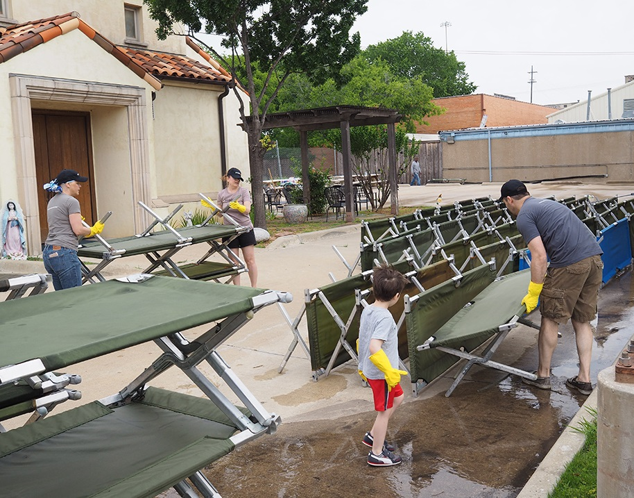 Allison Wolf, Karen King, Brad Grabowski and his son Bennett helped move and organize more than 400 cots.