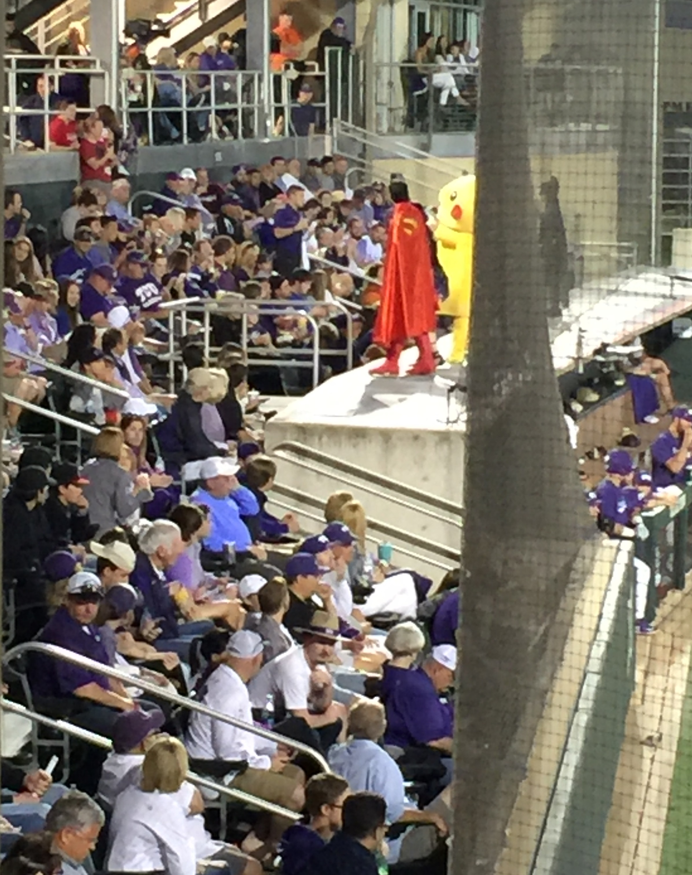 Daniel/Superman helps lead the crowd in cheering for participants in the children's costume contest.