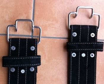 These are the Quick Release buckles. The Quick Release buckles were originally developed by powerlifiting legends Randy Wilson and Fred Hatfield.