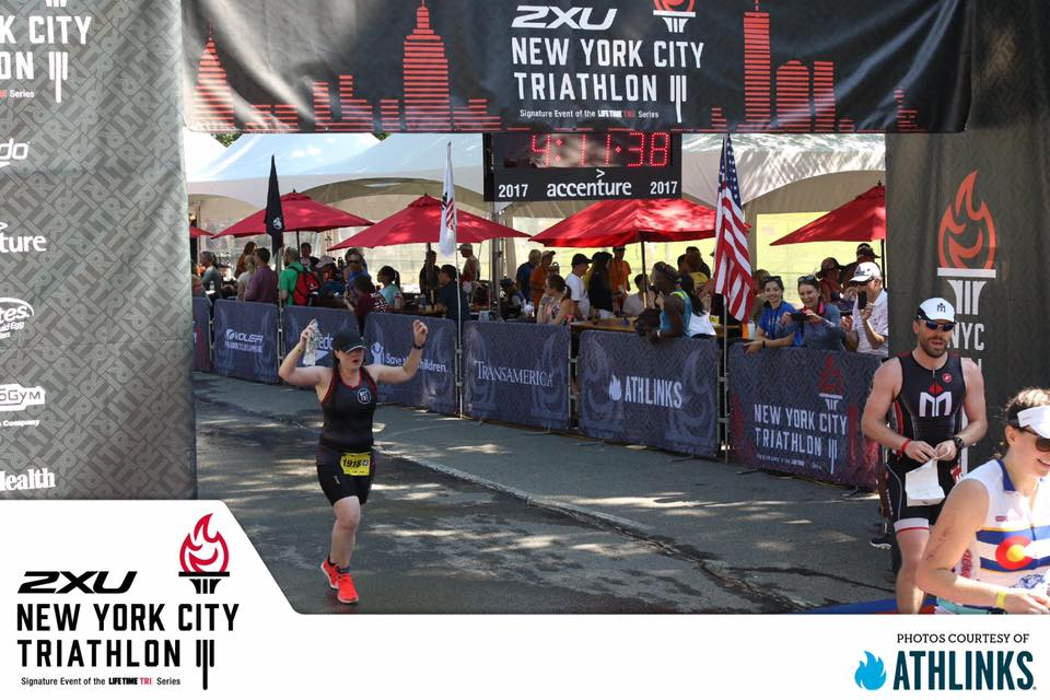 Kelly Crossing that NYC TRI Finish Line!