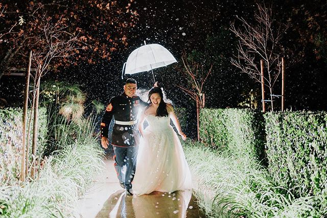 Happy Valentine's Day my loves!  It's raining, and it couldn't be more romantic! Remember I told you last time that I would never be afraid of rain again on a wedding day? (Sing that a la Alanis Morissette 😂) Look at Sheena and Joseph embracing the rain on their day! I cannot get enough of them!! -  Planner: @mo_to_love  Photo: @sessionsbyannesalas  Caterer: @richardjonespitbbq  Venue: #normanpmurraycommunitycenter  Videography: @boffovideo  Beauty: @bijouxbeauty.biz  DJ: @extremedjservice  Cake: @penelopesperfections  Photobooth: @viralboothoc  Rentals: @sigpartyrentals  Invites: @basicinvite Bar: @all_occasions_bartending