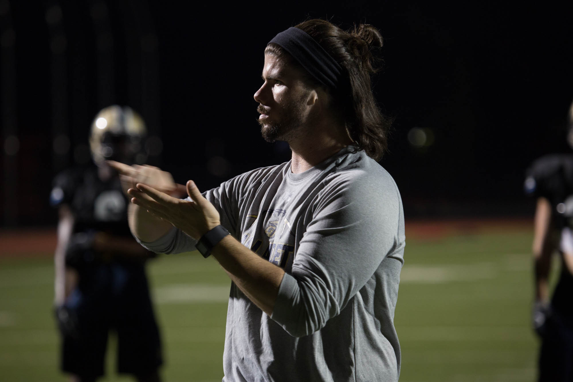 Shelby Bean, 25, signs a play to his linebackers during practice September 14, 2016 at Gallaudet University.