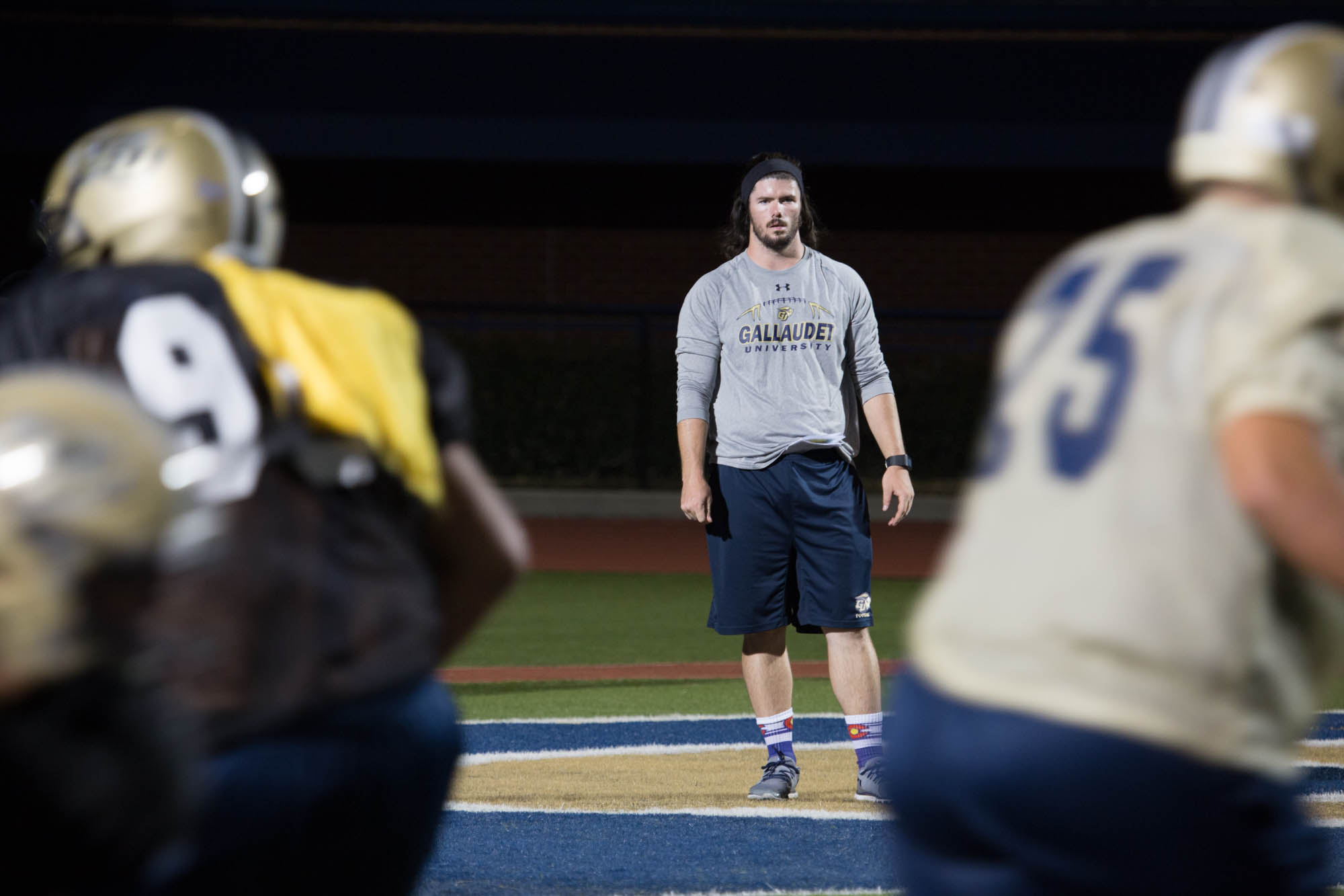 Shelby Bean, 25, watches his linebackers run a drill at football practice on September 14, 2016 at Gallaudet University in Washington, D.C.