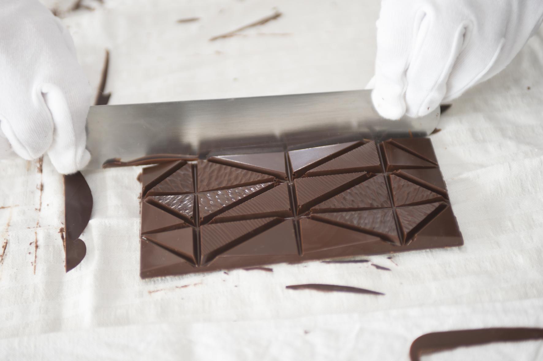 Garçoa bean to bar chocolate production - Fine tuning Garçoa bars after removing from the moulds.jpg