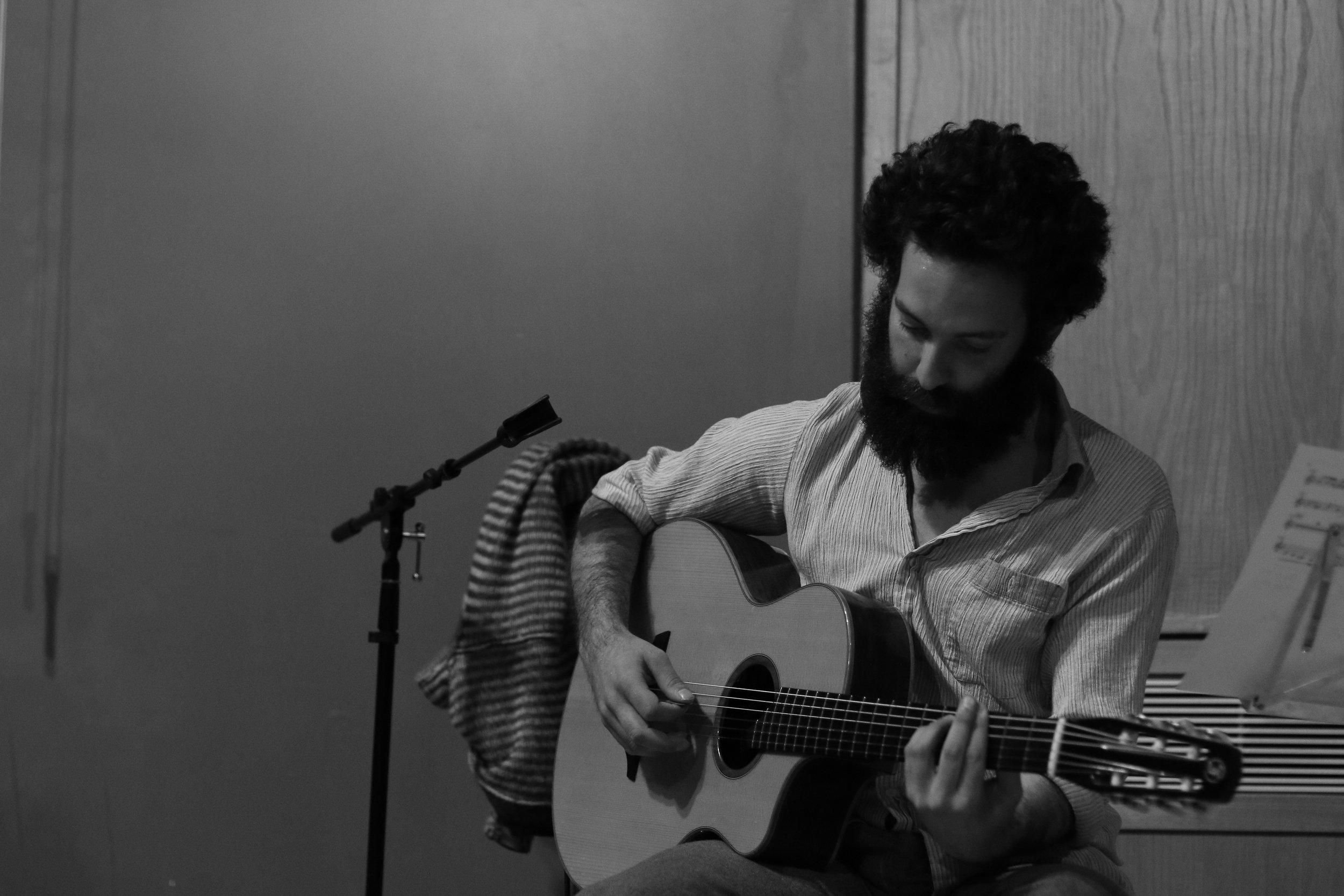 Tim Karp playing music at An Evening of Norse Mythology. Photo by Jordan Laith Rawi.