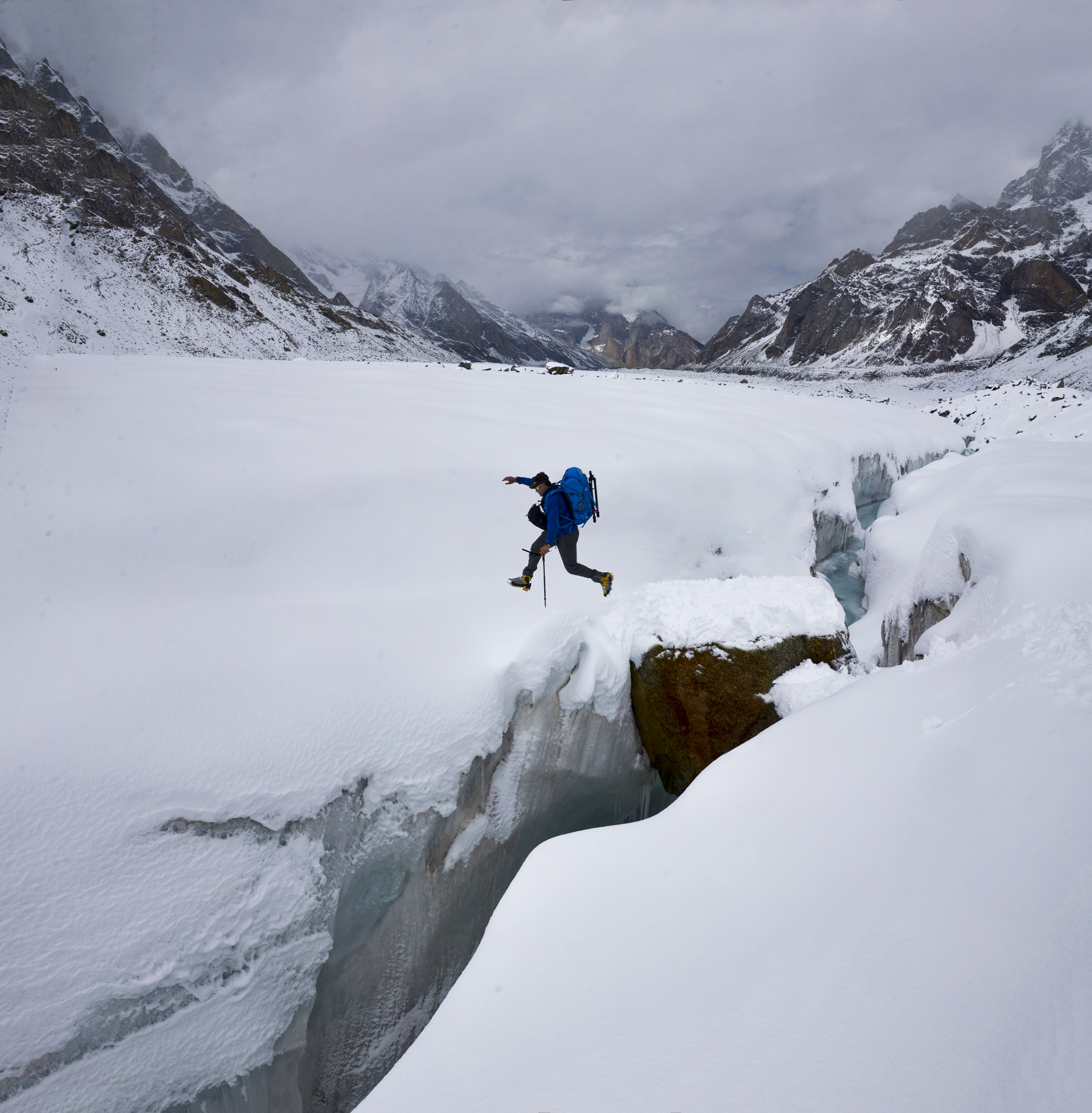 Pete McBride leaps a crevasse on the Gangotri Glacier, Uttarakhand, India. Photo © Jake Norton.
