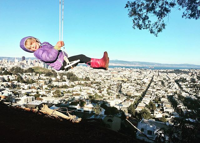 """""""Mom, whenever I go back, it makes the whole city small.  When I go forward, it makes the city big"""" #swingbombsf @swingbombsf Repost @saltedlife: . . . . . #sanfrancisco #sfviews #weekendvibes #instagood #igerssf #swing #redboots #childsplay #playgroundlife"""