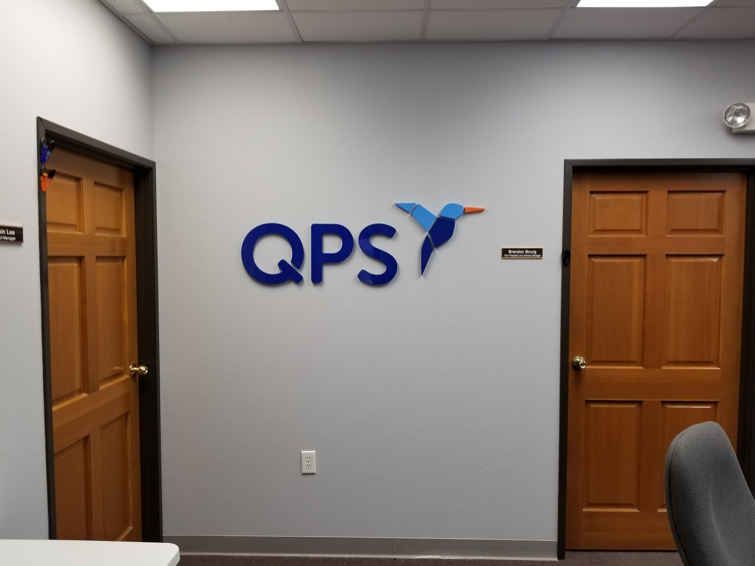QPS - Updated wall sign