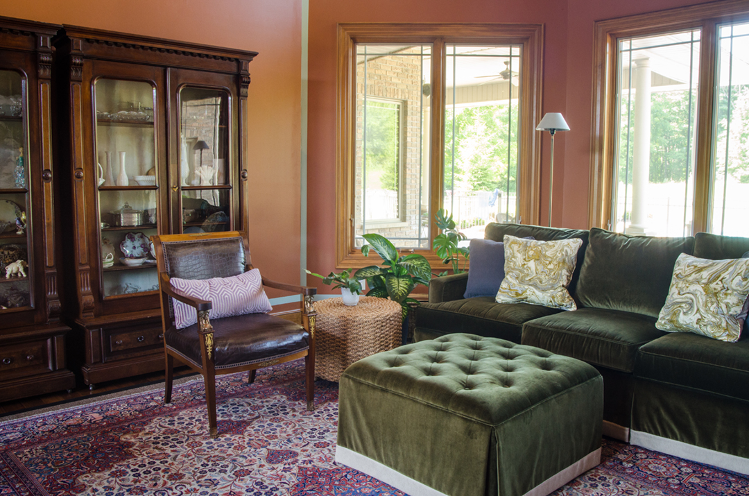 The green velvet sofa helped make this voluminous space feel cozy and comfortable.