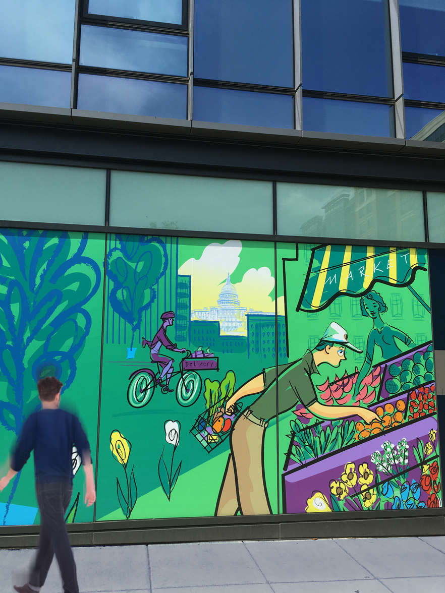 this section of the window display depicts a man at a neighborhood market, with the Capitol building seen in the background.