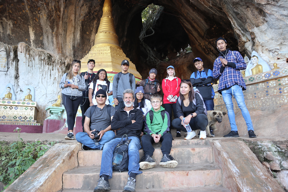 Team shot (with obligatory scruffy dog) outside the Buddha cave