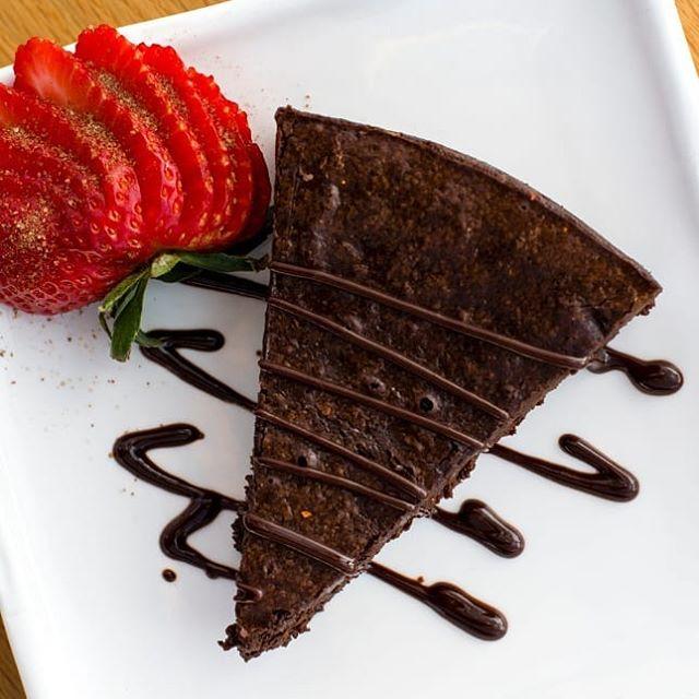 Flourless chocolate cake made with Ghirardelli chocolate chips. Mmmmmm, share baby, share #tillerykitchenandbar  #austinmonthly  #austinweddingvenue  #austineats #dessertstagram  #atx_bites  #austinfoodadventures  #chocolatecake