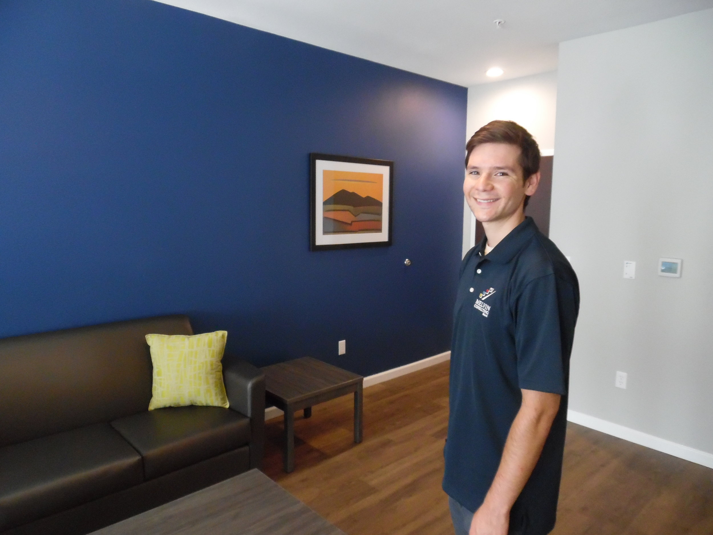 Darick Melvin (Melvin Consulting) admiring a feature wall in the apartment unit