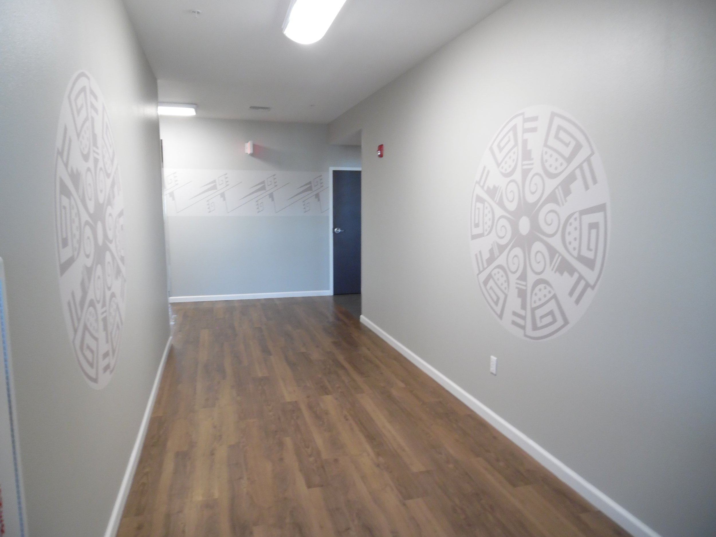 Corridor with Hopi art mural by Hopi artist Michael Adams