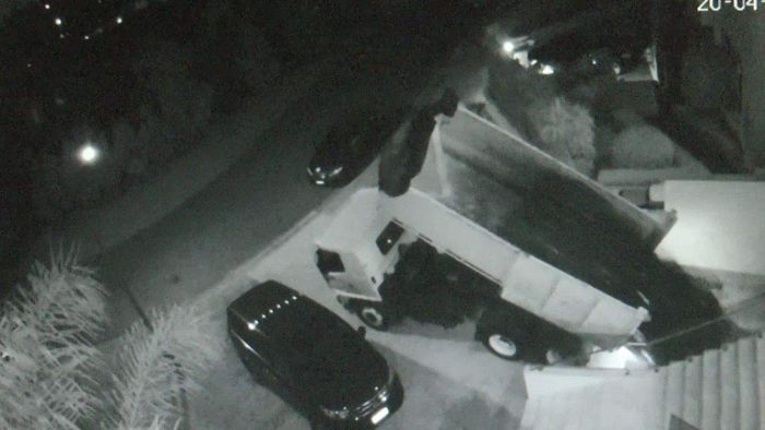Security camera footage of a truck dumping suspected asbestos in the driveway of an Oatlands home.