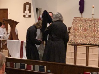 Br. Carter-Juan is clothed. - The Benedictine habit is given to the newly professed.