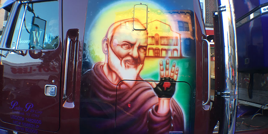 Filippo A. Barone enjoys riding the Valentino food delivery truck with a beautiful mural of Padre Pio painted on driver's side.