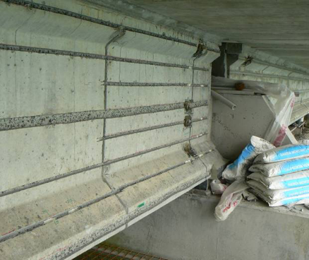 Slots cut for ICCP ribbon anode installation at New Zealand's Calliope wharf. Hydro-demolition holes at the end of beams to establish continuity.
