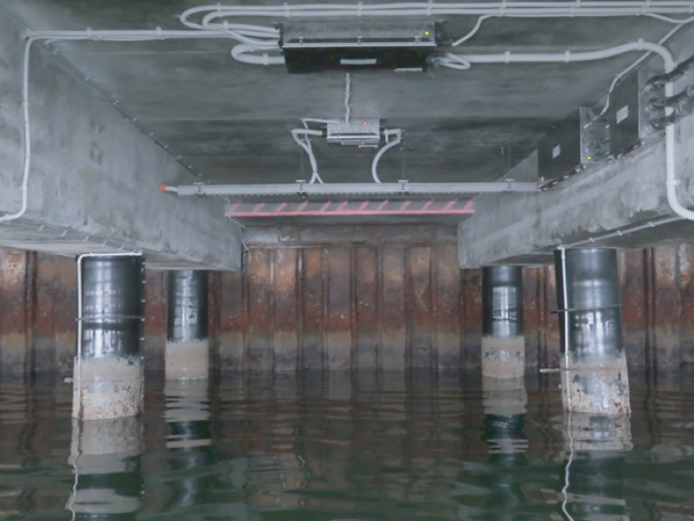 "The concrete and water anode control systems are AC powered and ""distributed"" below the wharf deck, thus maximizing the power efficiency of the system and minimizing the cost of cabling."