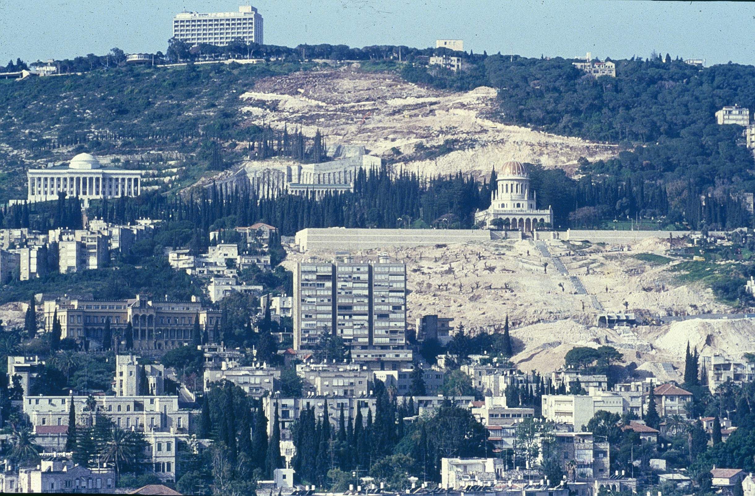 The 1990s witnessed the challenging task to build garden terraces from the bottom to the top of Mount Carmel. This photo show the site being prepared for construction of the terrraces.The completion of the project fulfilled the vision of 'Abdu'l-Baha and provided an exquisite setting for the jewel that is the Shrine of the Bab.