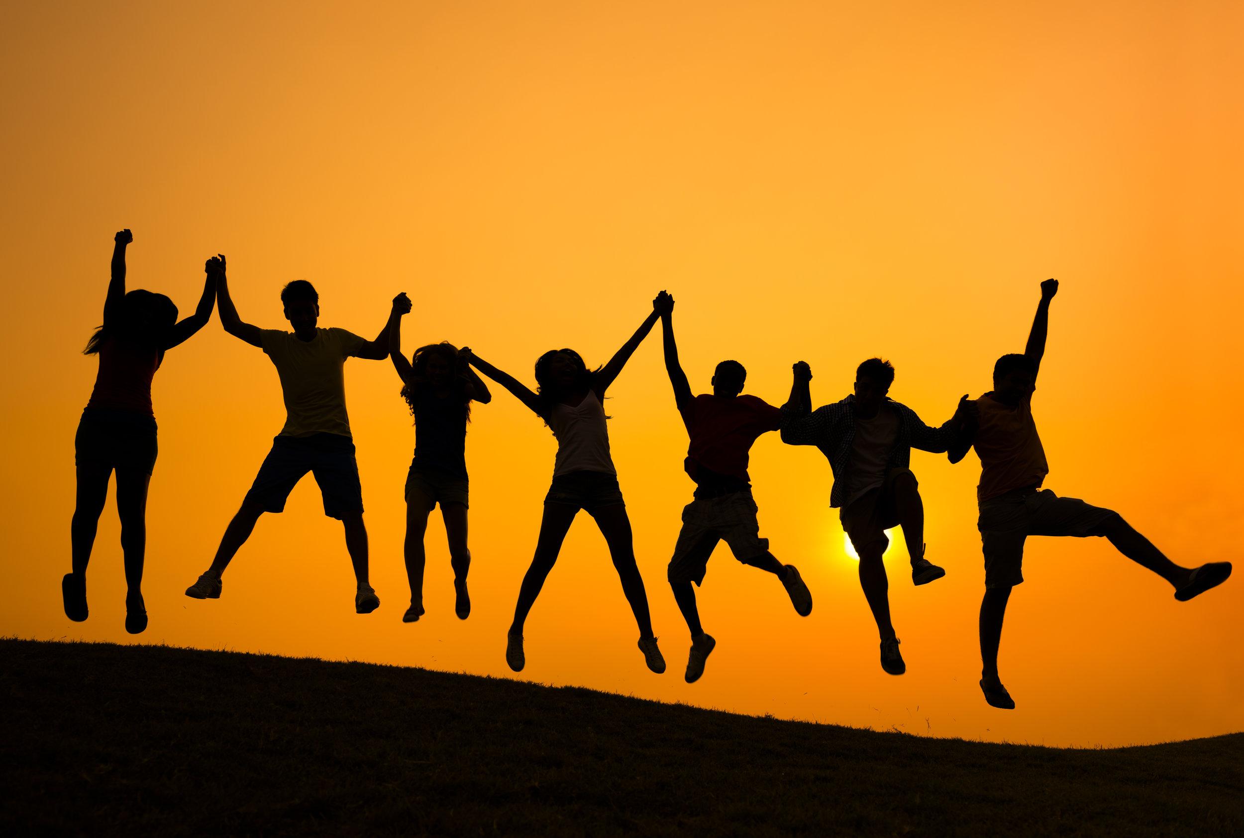 Team enjoying a sunset, come meet the team