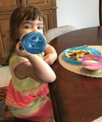 Sydney, aged 3, enjoying her baked french toast with yogurt on the side
