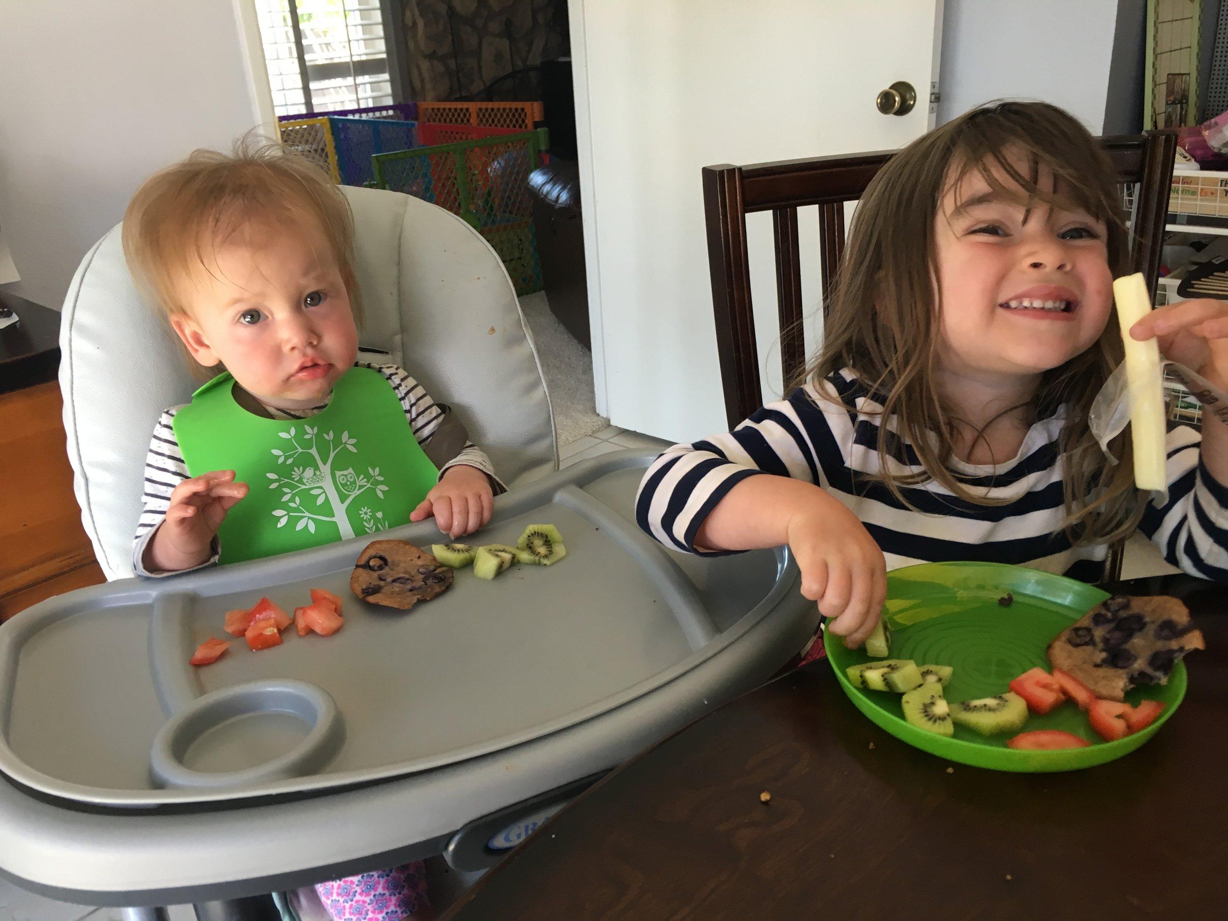 Alex, 1 year, and Sydney, 3.5 years, enjoying lunch.