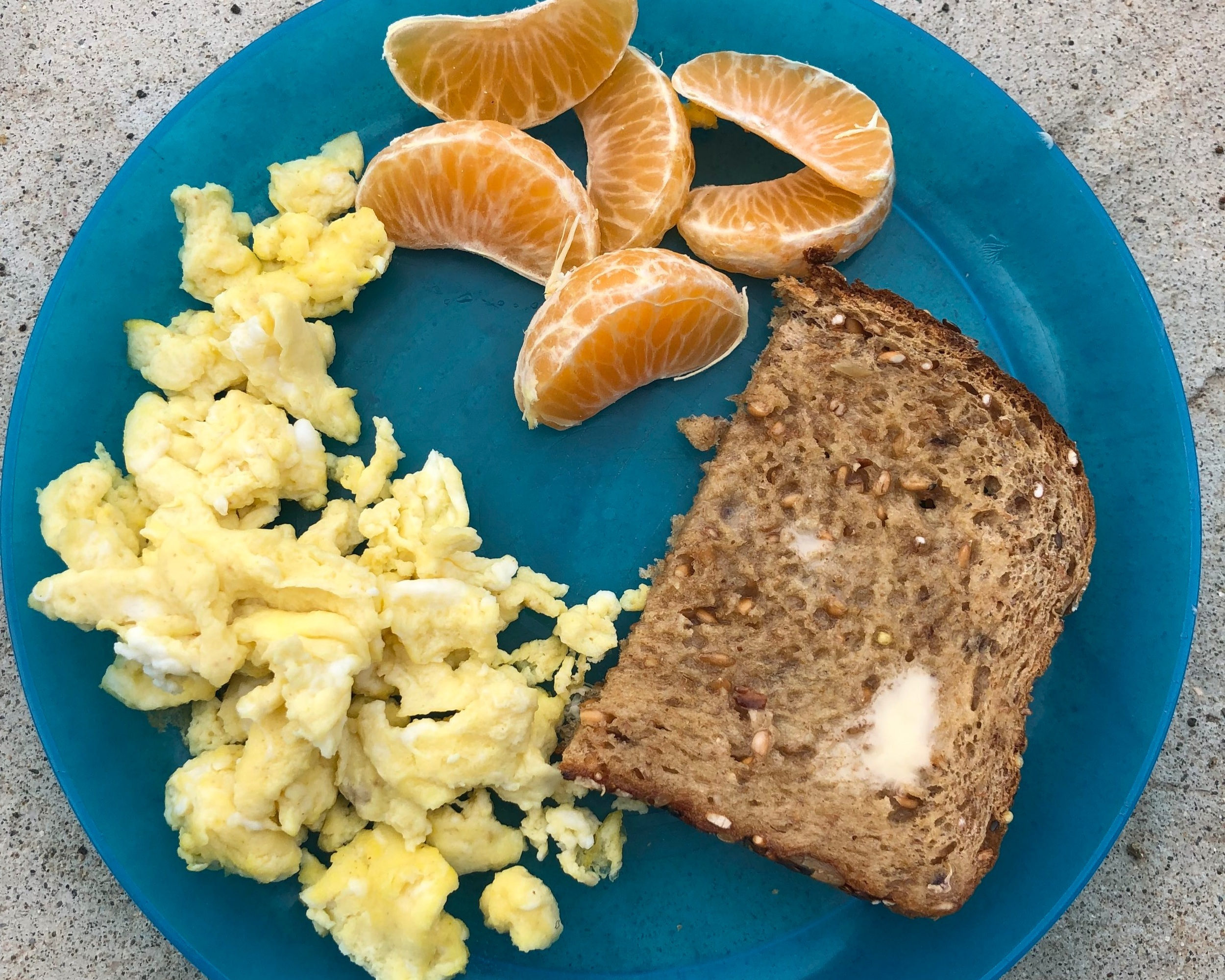 Day 3 - Scrambled eggs, toast and fruitScrambled eggs are my favorite breakfast food. They are easy and packed with nutrition. But, I know, along with everything else, I can't serve them every day or a food jag will happen. I occasionally add seasoning to my eggs, like garlic powder and cumin. Bonus if my 4 year old helps me as well - when she helps me prepare the food, she is more likely to eat it at breakfast time!