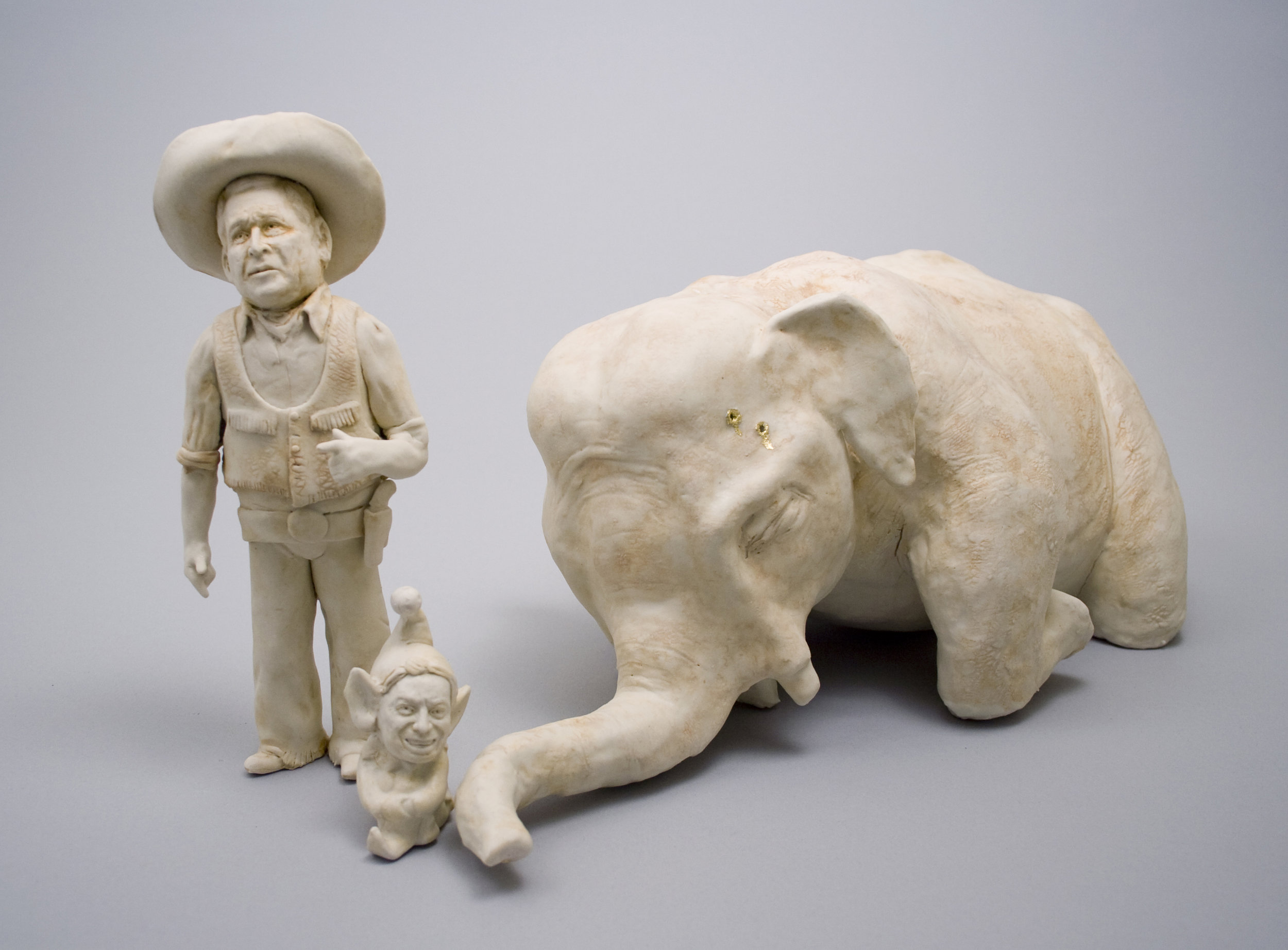 "Shooting a White Elephant    Glazed Porcelain, gold leaf. 9""h x 22""l x 8"" w  April 2006"