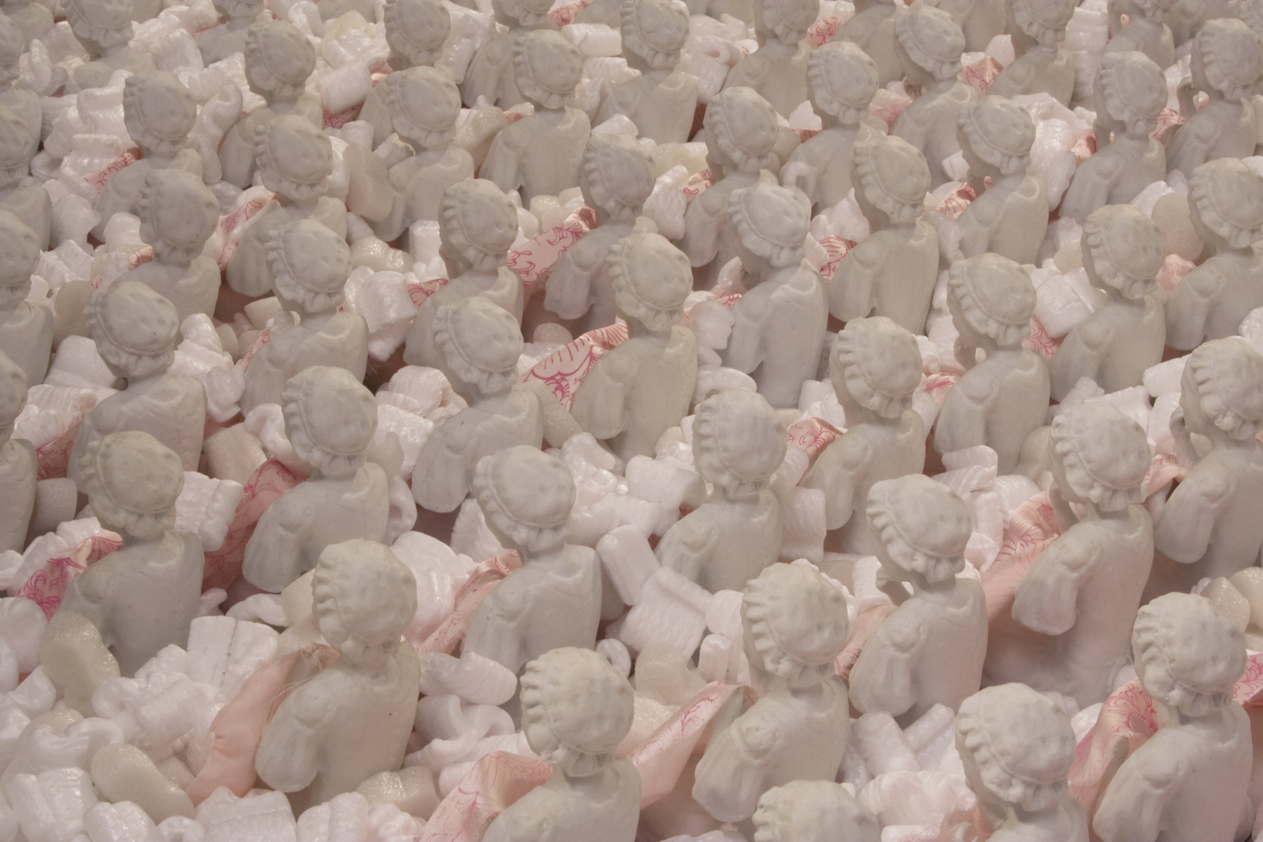 "Over-Identification with the Other  450 unglazed outsourced porcelain figurines made in China, silk, screen-printed silk, cardboard, styrene peanuts 39"" h x 9' w x 9' d 2008"