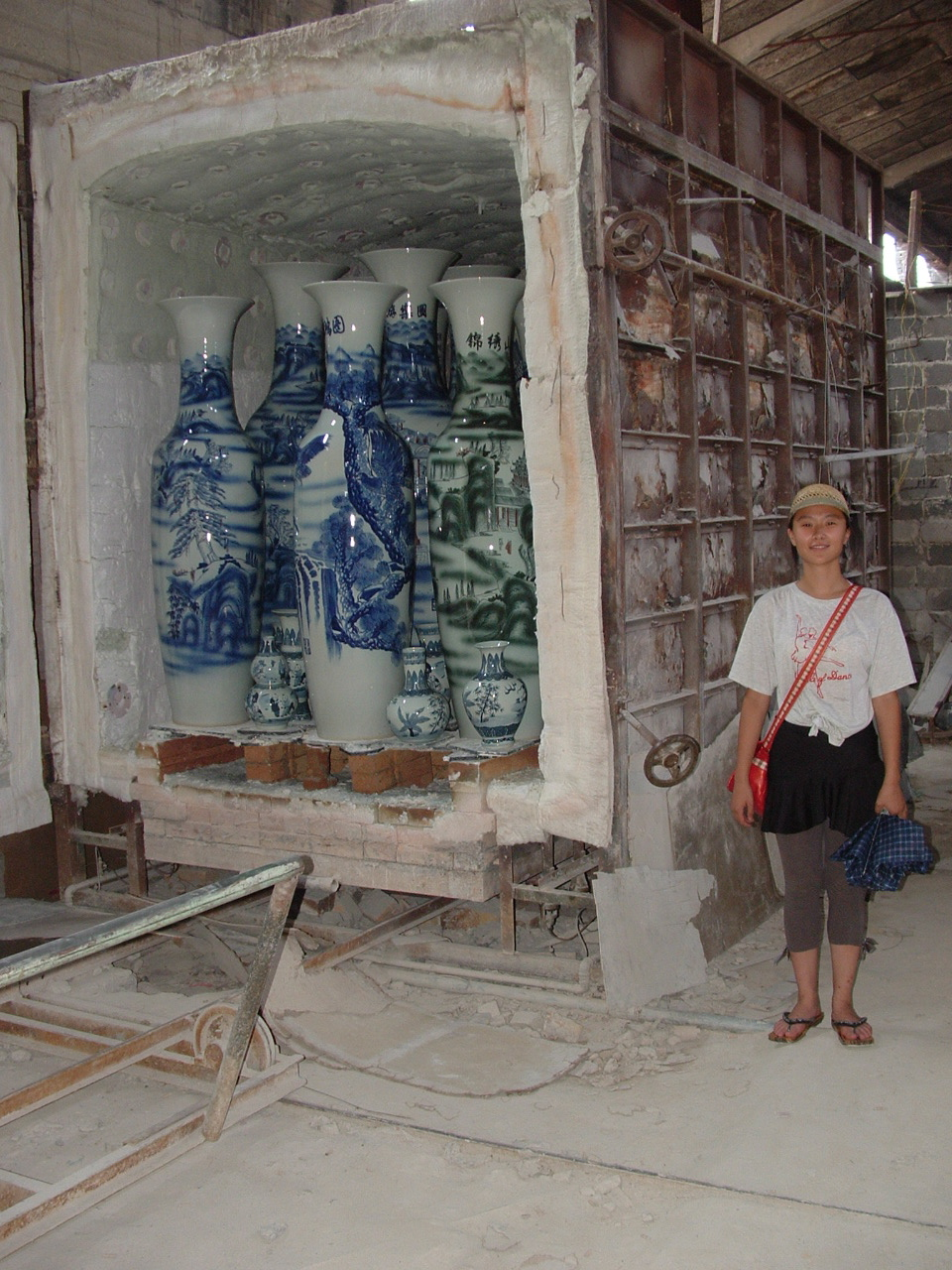 my guide, Baixu, and a kiln full of recently fired work