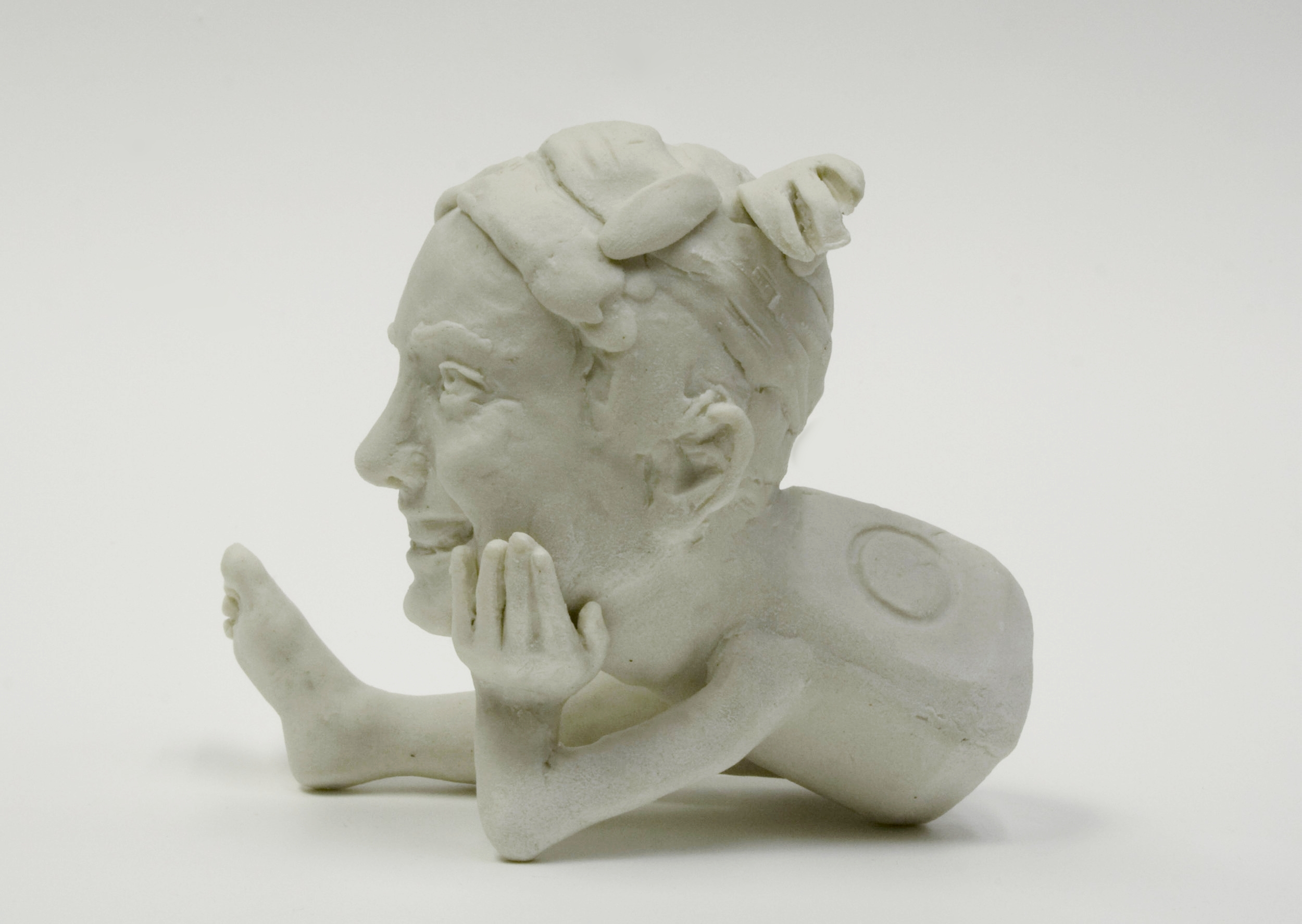 """detail:  Portrait of the Artist as a Commodity, #1.2    unglazed porcelain, approx 2.5"""" h  Spring 2007"""