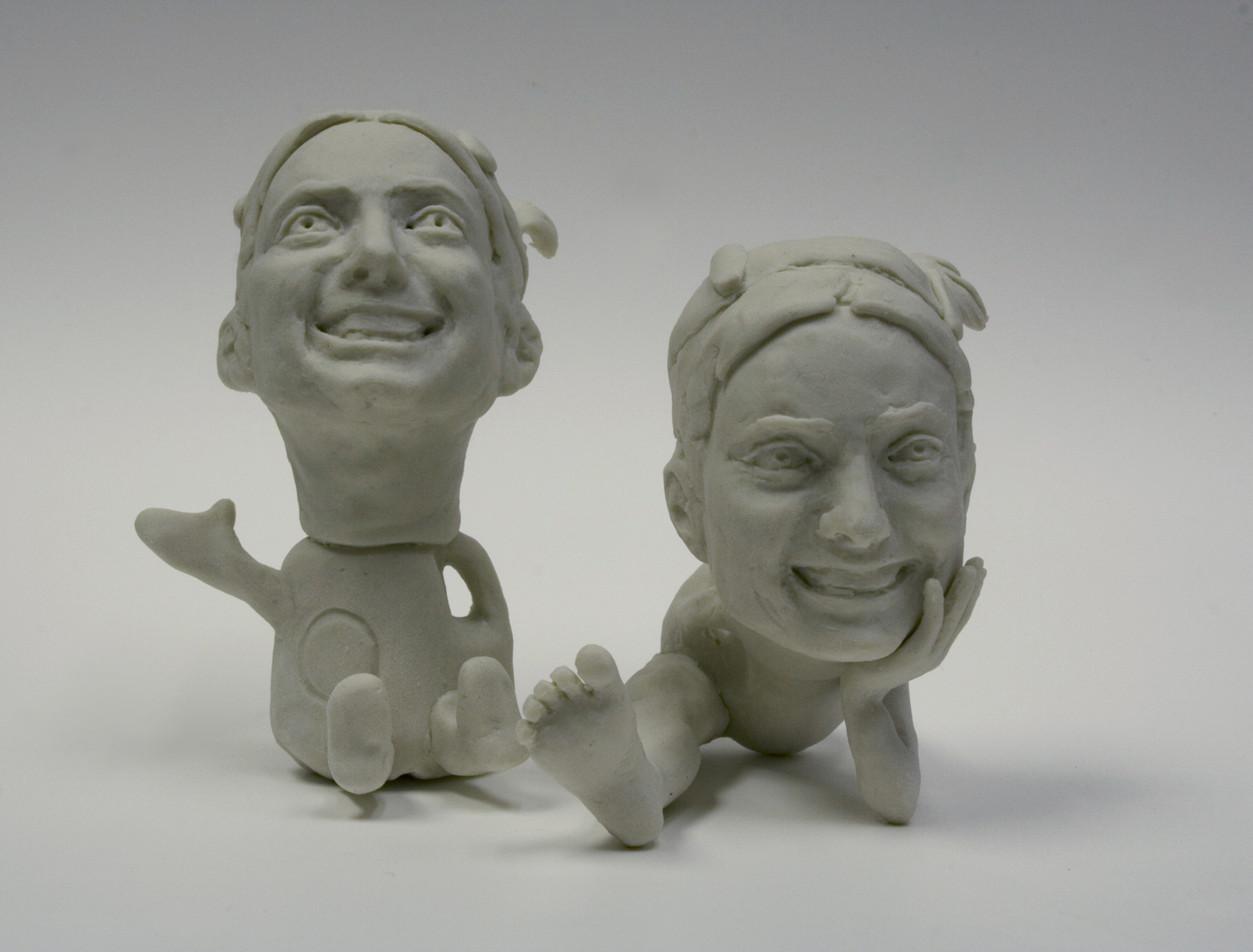 """Portrait of the Artist as a Commodity, #1.1, 1.2.    unglazed porcelain,3"""" h or less  Spring 2007"""