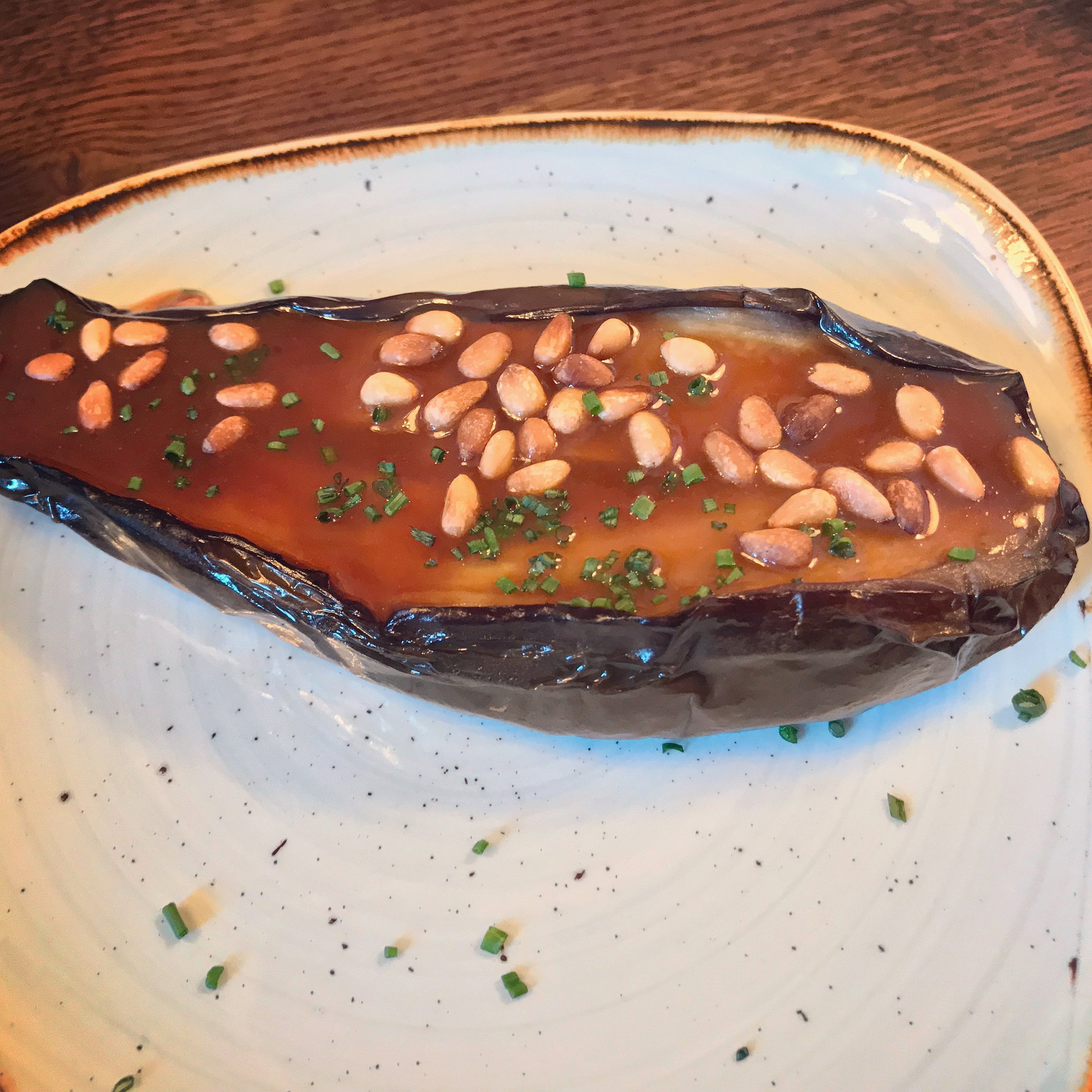 Aubergine confit-style with honey and pine nuts