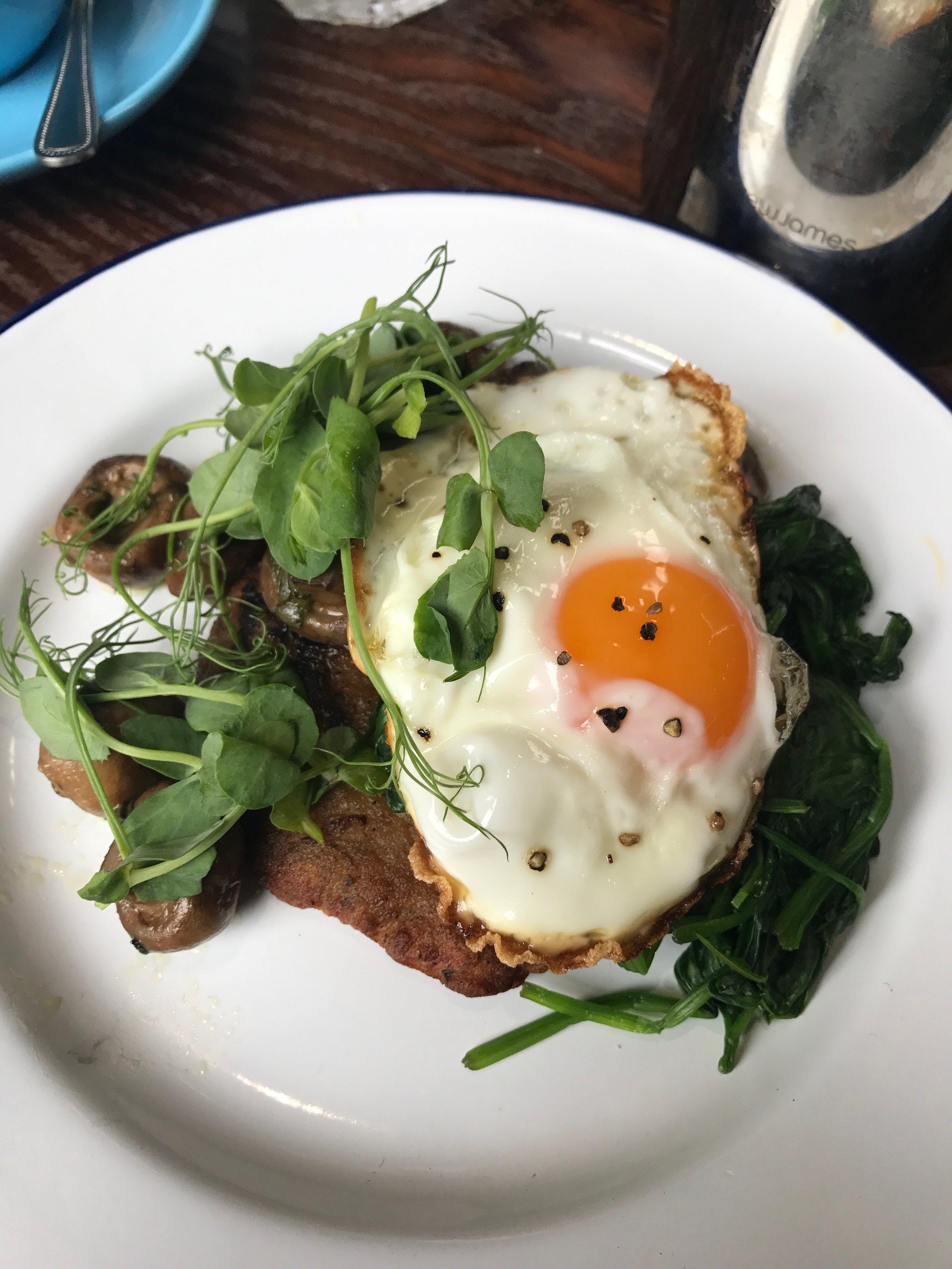 Truffled tattie scone, roast mushrooms, spinach and fried egg