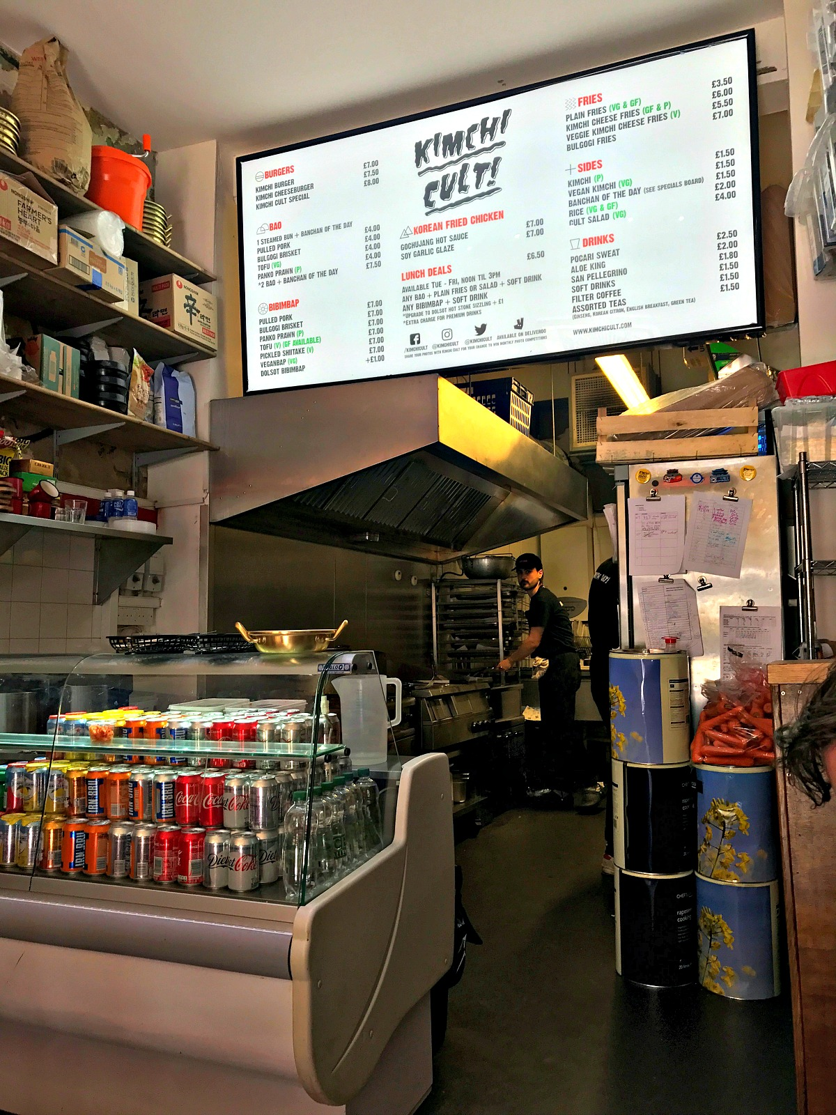 Inside Kimchi Cult looking into the kitchen and at the lovely new menu sign overhead
