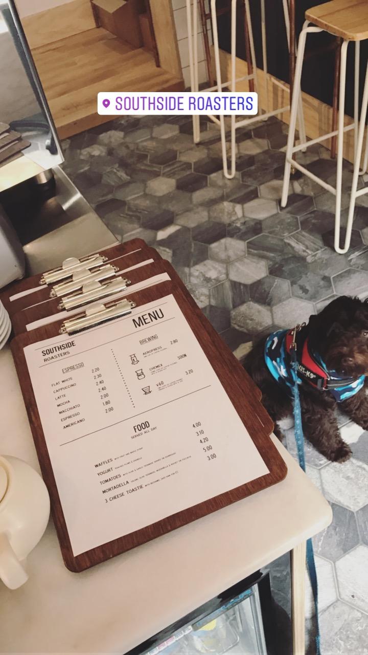 Southside Roasters with Joffrey peeking at the menu