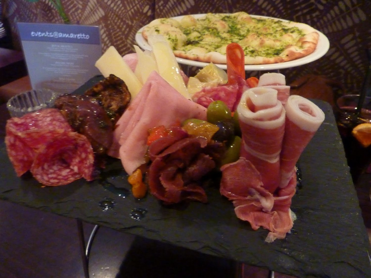 Antipasto Misto - a selection of imported Italian cured meats and vegetables, accompanied with a rosemary focaccia (below) £13.95