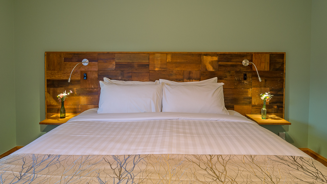 Rimu Feature Headboard with External Cladding salvaged and reused from house.jpg