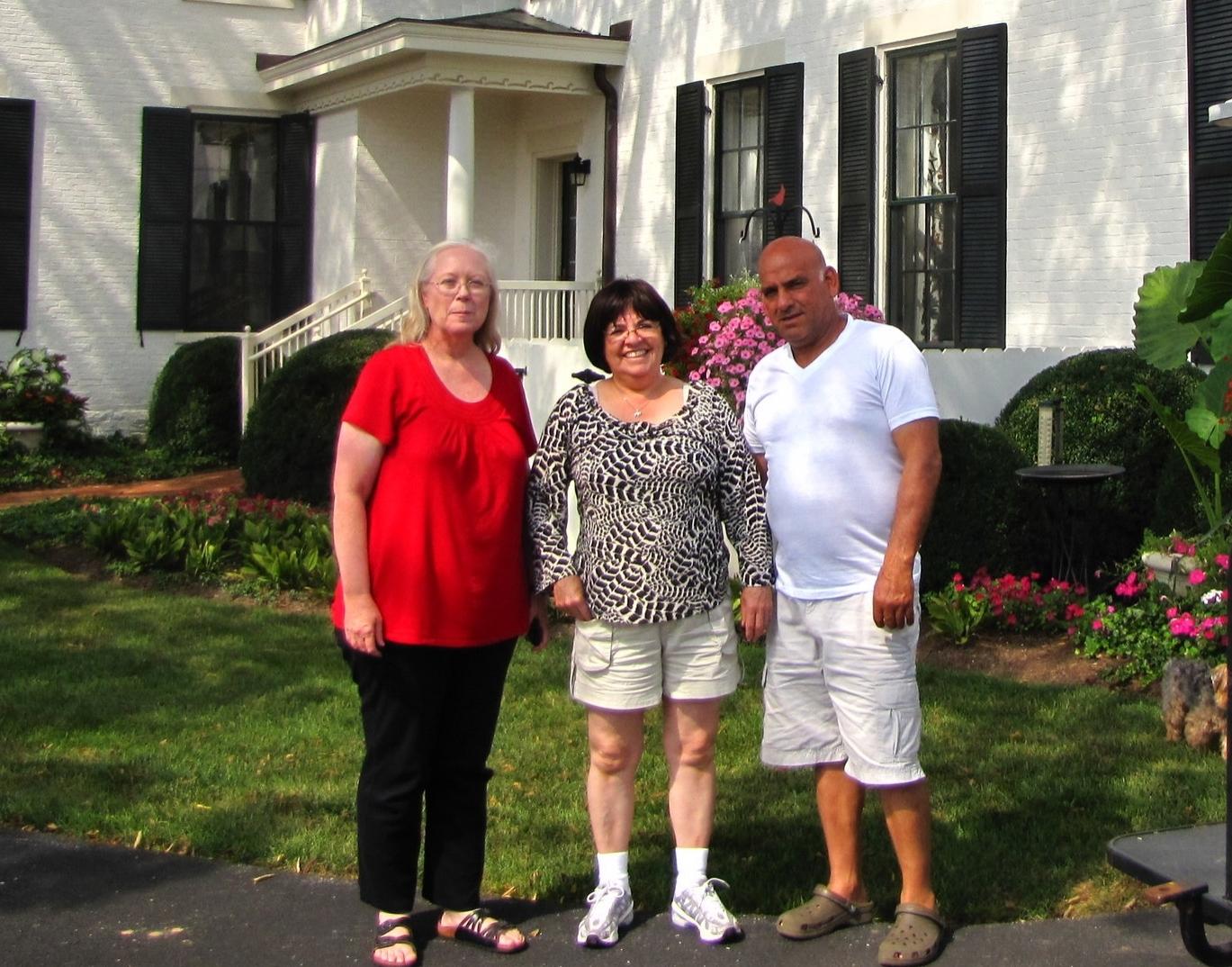 Barbara standing next to Martina and her husband, Reuben