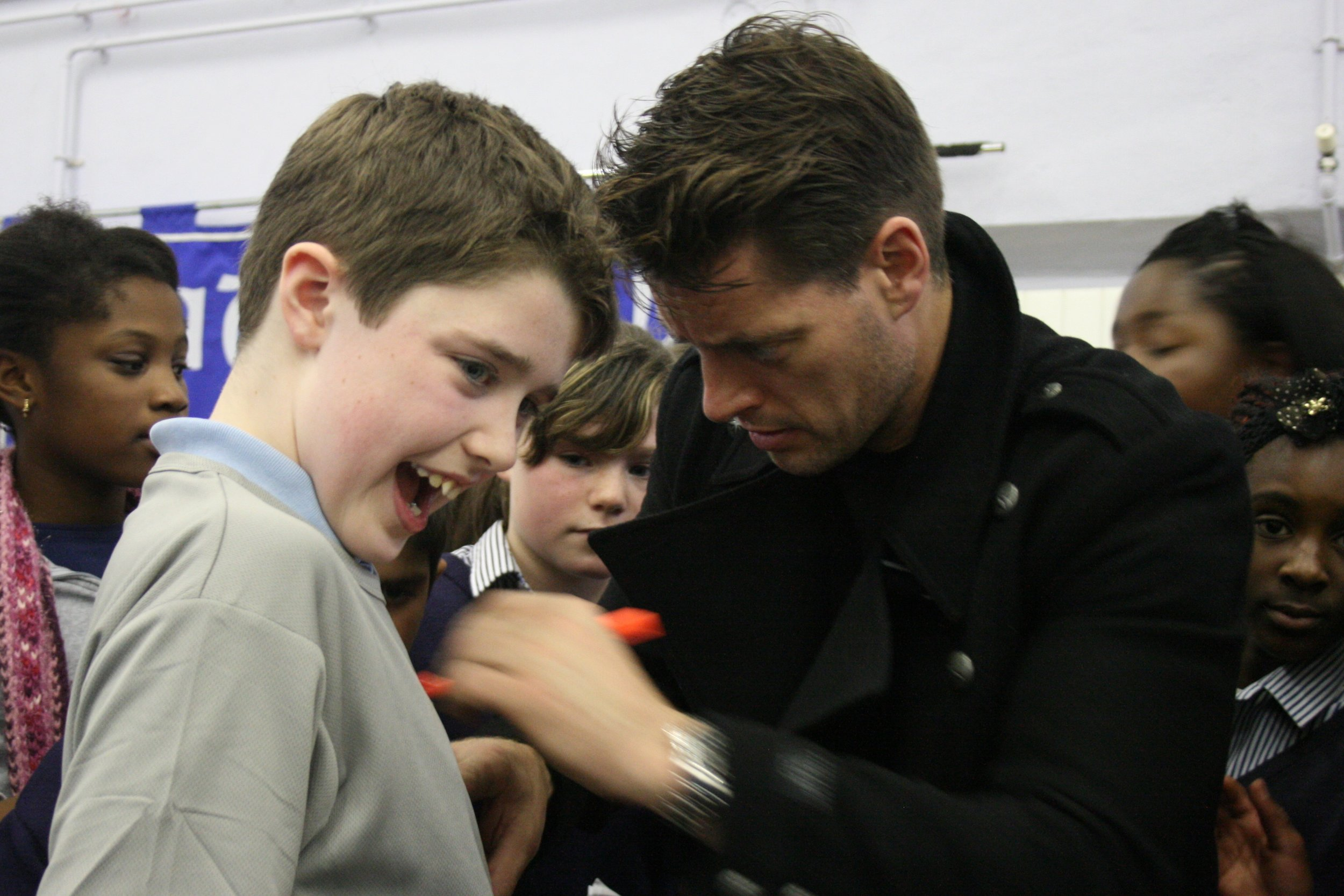 Keith Duffy signs Lorcan Cameron's t-shirt at Claddagh N.S..JPG