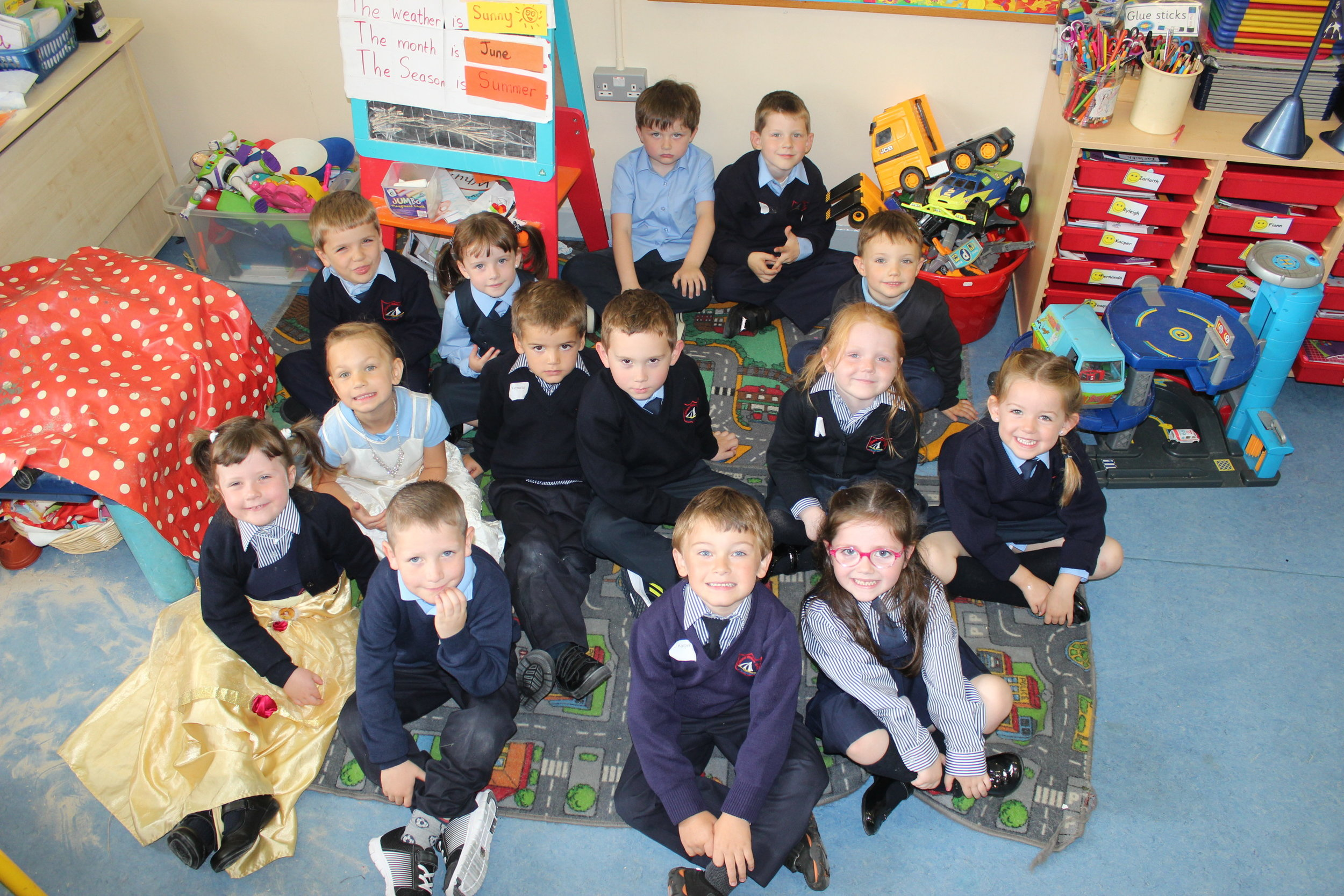 Ms. Ferguson's Junior Infants get ready for storytime after some Aistear play (including dress-up!).