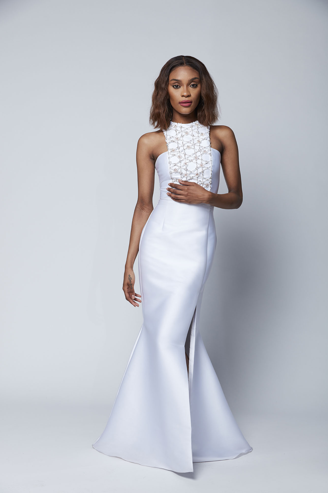 Paired with our angled Tara skirt, the hand embroidered Bronwen top has texture, a hint of color and just the right amount of sparkle for the fashion forward bride.