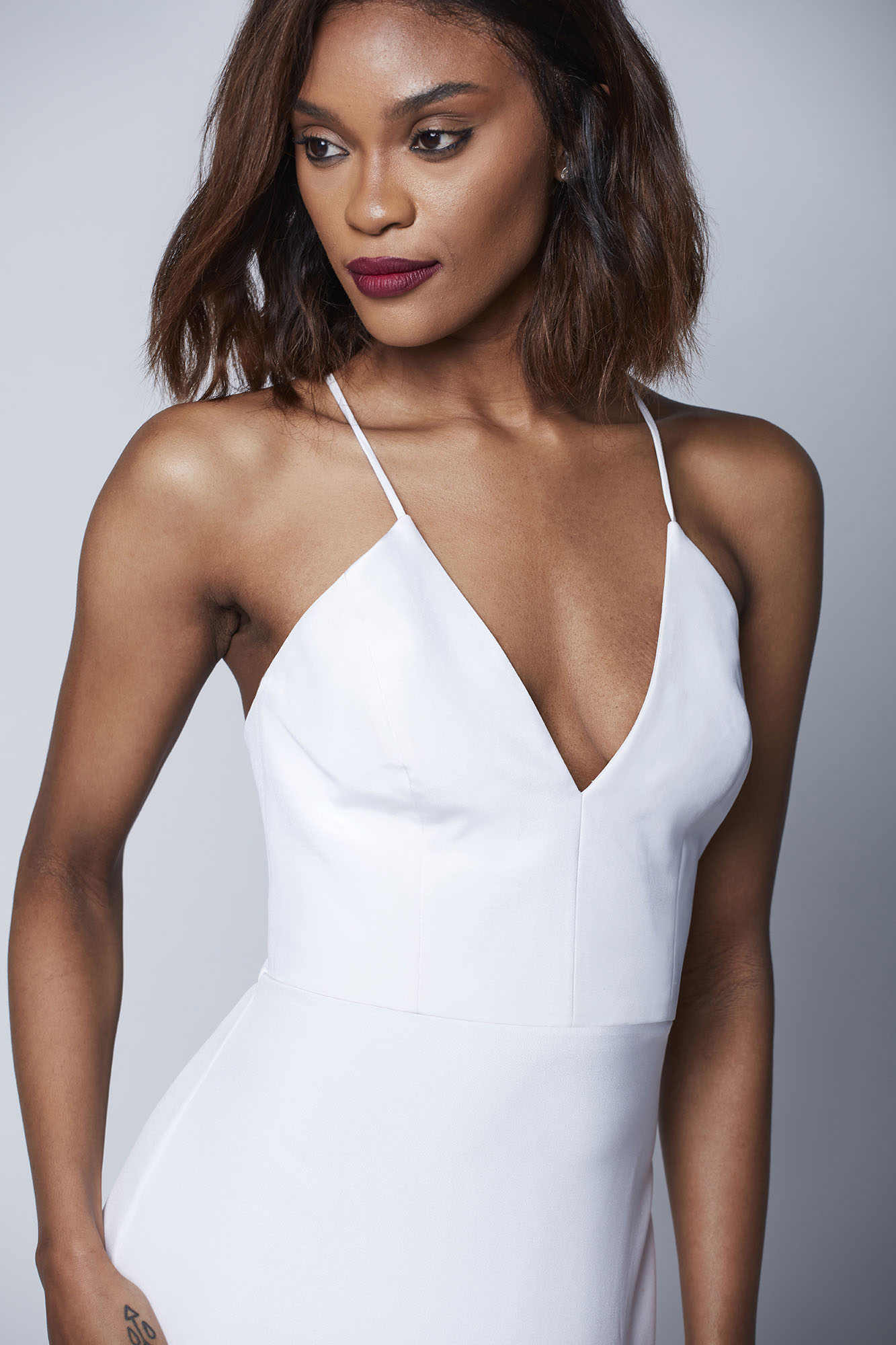 This strappy bustier features an elongated V that pairs perfectly with the slim Talia skirt for an easy, sophisticated look.