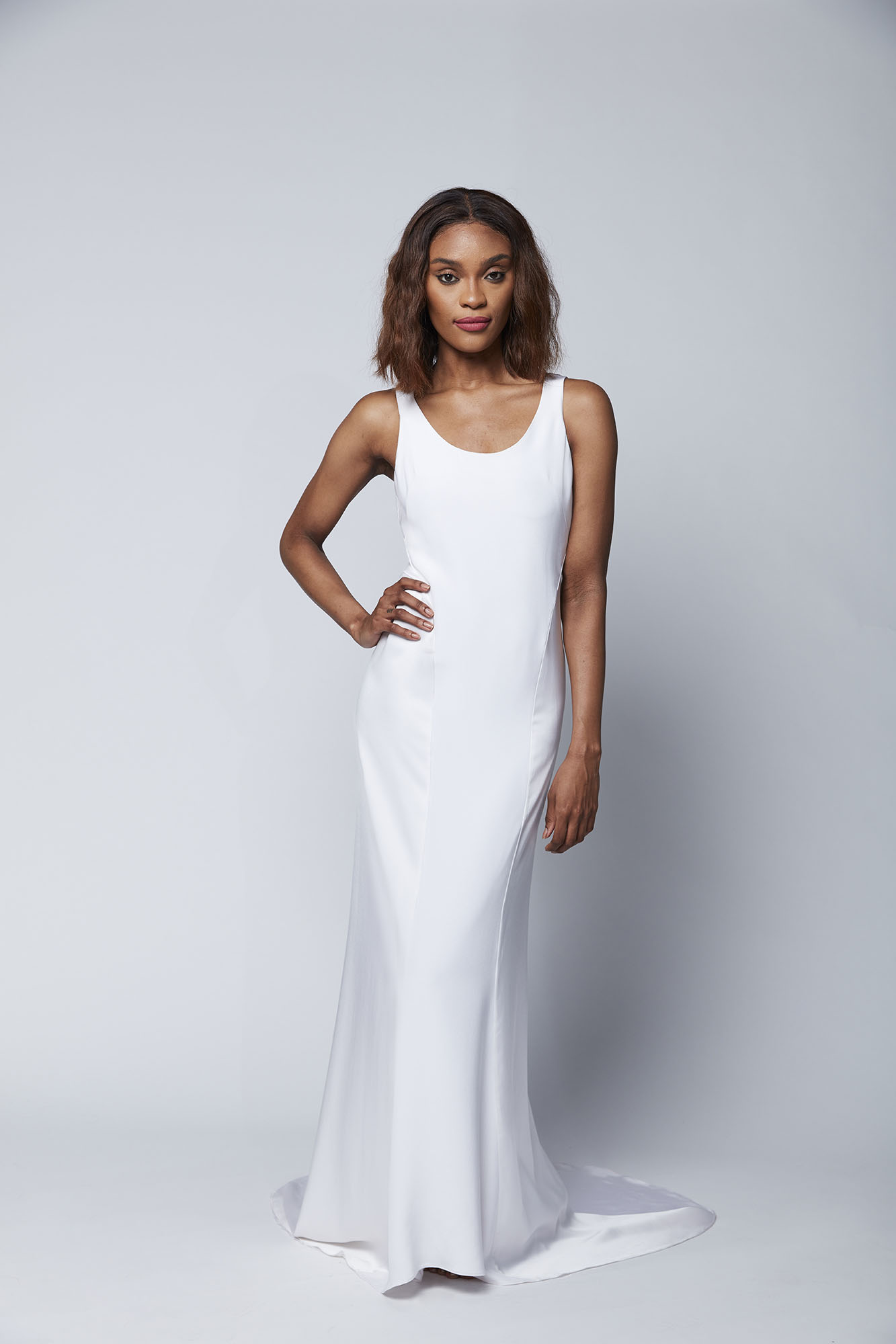 This slinky tank dress with satin side paneling and a low V back is the perfect look for the no frills bride who is seeking effortless chic.