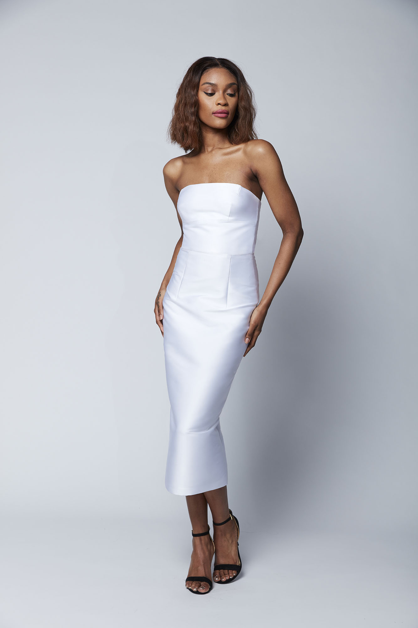 The strapless Ellie bustier and midi skirt are a perfect match for the bride who wants a sophisticated look while enjoying ease of wear.