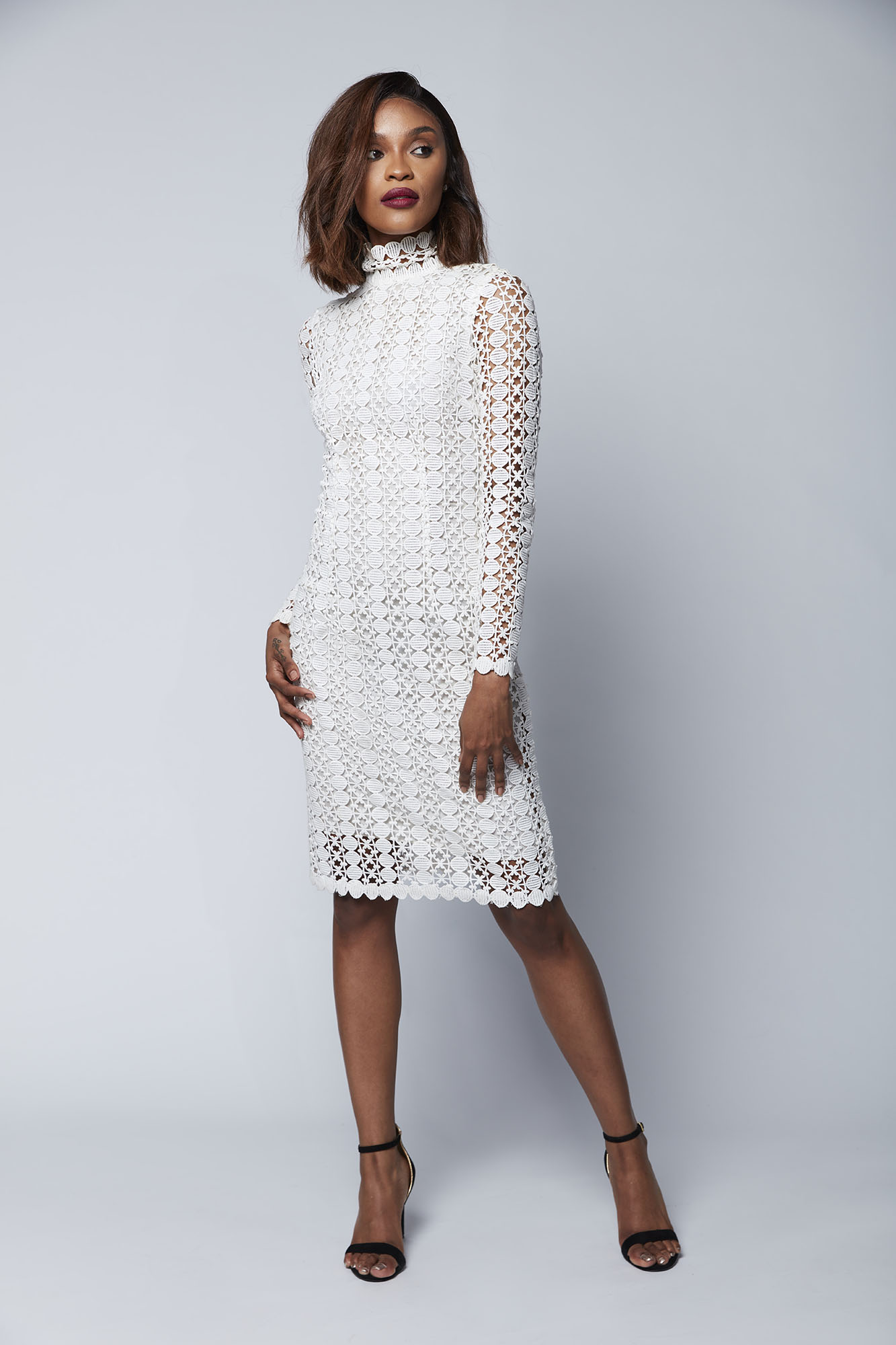 This long-sleeved high neck dress features an ultra-lightweight Japanese cotton lace that is ideal for the bride seeking a simple yet elegant look for her pre-wedding, wedding or after party look.