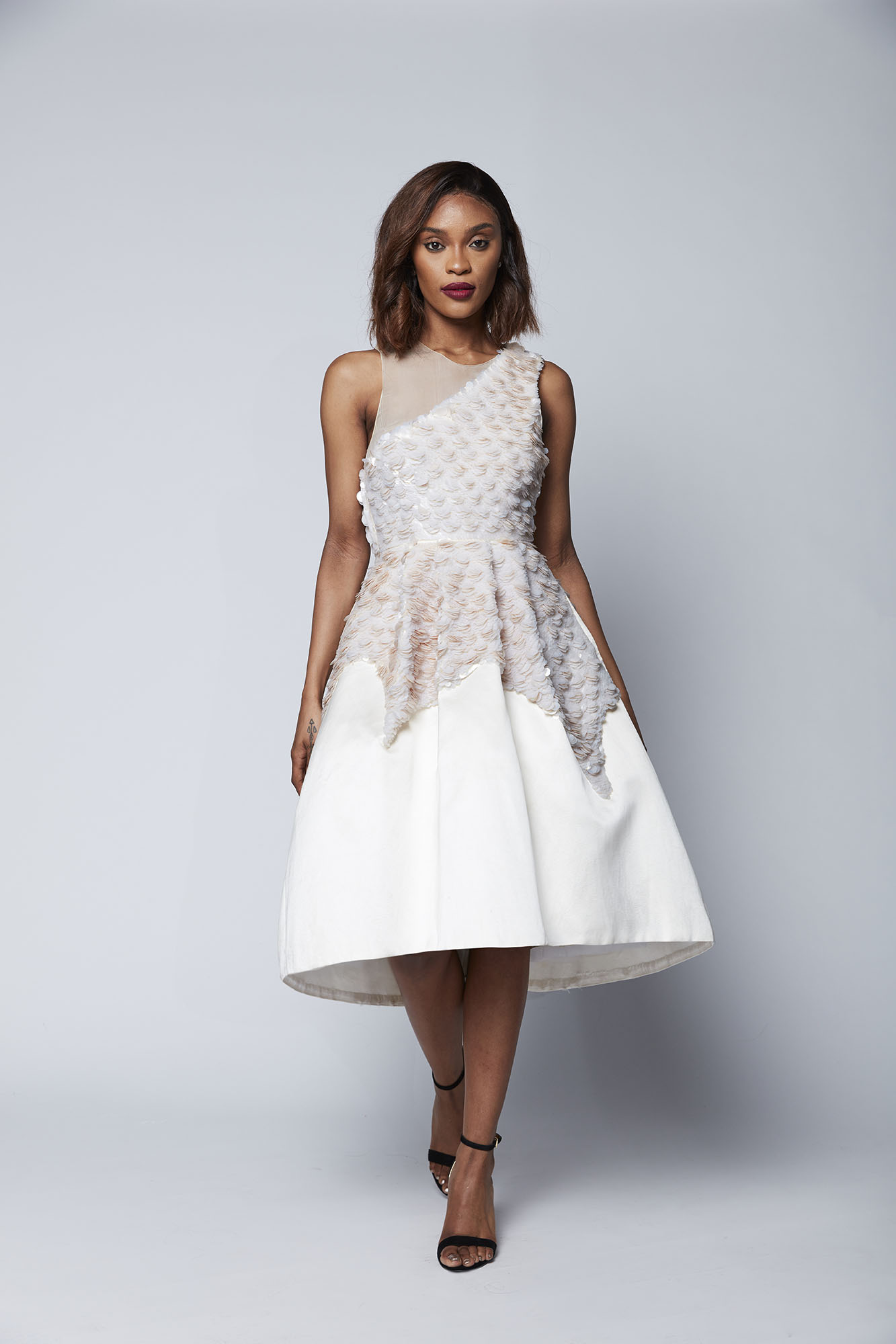 This dramatic tea length dress of layered opaline sequins creates a show stopping look that is perfect for the most glamorous of occasions and ideal for the bride who wants to dance the night away.